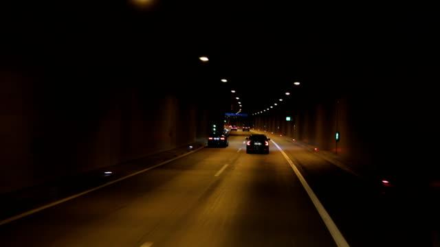 rida på natten med bil genom tunneln - bakljus bildbanksvideor och videomaterial från bakom kulisserna