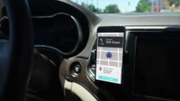 Ride Sharing App Screen on Smartphone in Car