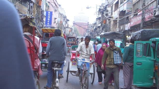 Ride through busy street, New Delhi