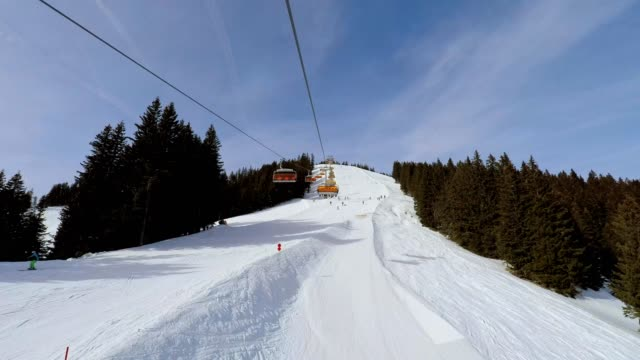 POV, ride with the chairlift in winter, Bolsterlang, Allgau, Bavaria, Germany