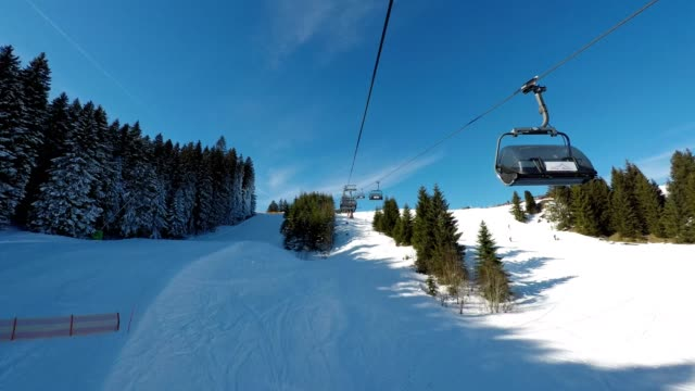 pov, ride with the chairlift in winter, ofterschwang, allgaeu, bavaria, germany - overhead cable car stock videos & royalty-free footage