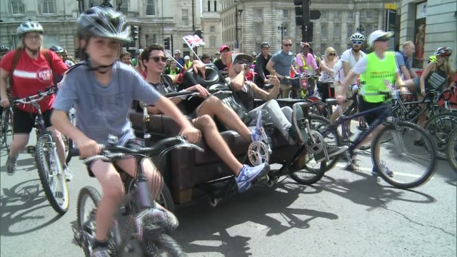 london ext **music heard sot** cyclists along during ride london 2015 including two men on customised 'sofa' bike ends - customised stock videos & royalty-free footage