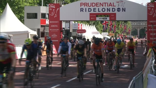 Final day features ride out to Surrey and back to The Mall ENGLAND London EXT Boys cheering during the RideLondon cycling event Various of cyclists...