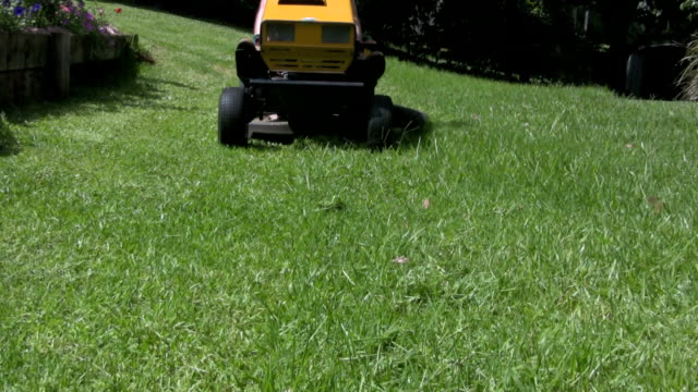 ride-on lawn mower approaching - lawn mower stock videos and b-roll footage