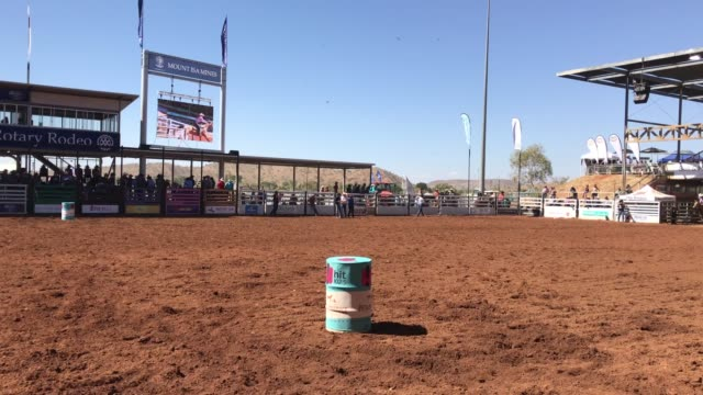 a rider competes in the barrel race competition of the 2018 mount isa rotary rodeo at the buchanan park events complex on august 12 2018 in mount isa... - southern hemisphere stock videos & royalty-free footage