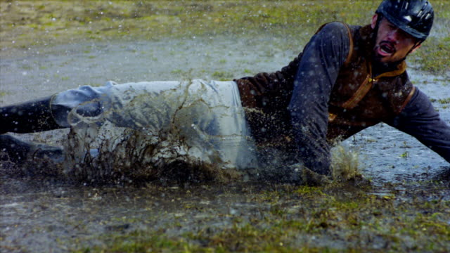 rider falls off horse - mud stock videos & royalty-free footage