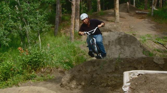 Rider on BMX stunt track