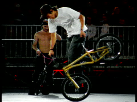 bmx rider performs series of twists turns spins and stunts other rider shows appreciation of skills by banging bike oberhausen germany - spielkandidat stock-videos und b-roll-filmmaterial