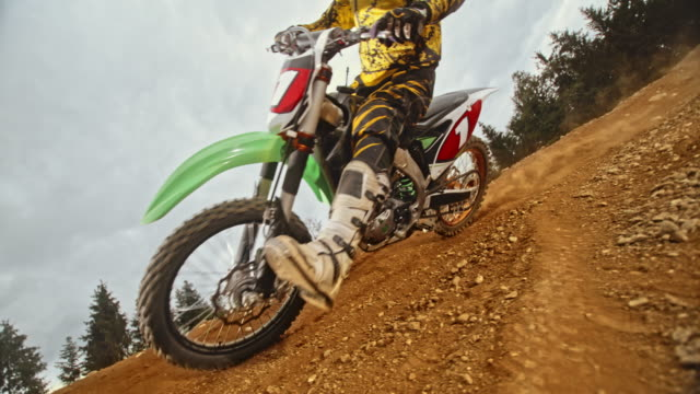slo mo rider riding his motocross bike in a turn - professional sportsperson stock videos & royalty-free footage