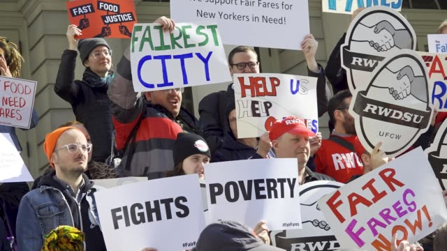 riders alliance and community service society of new york hosted a rally on the steps of new york city hall on wednesday april 11 activists and... - around the fair n.y stock videos & royalty-free footage