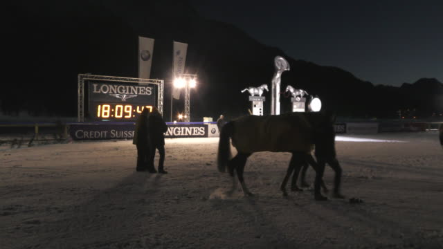 riders and horses before the night turf competition on february 5th 2016 in st moritz - nordic skiing event stock videos and b-roll footage