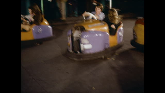 montage riders of all ages having fun while driving bumper cars / united kingdom - bumper car stock videos & royalty-free footage