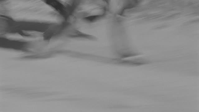 vídeos de stock e filmes b-roll de ms ts pan riders riding on dirt road  - rasto de movimento