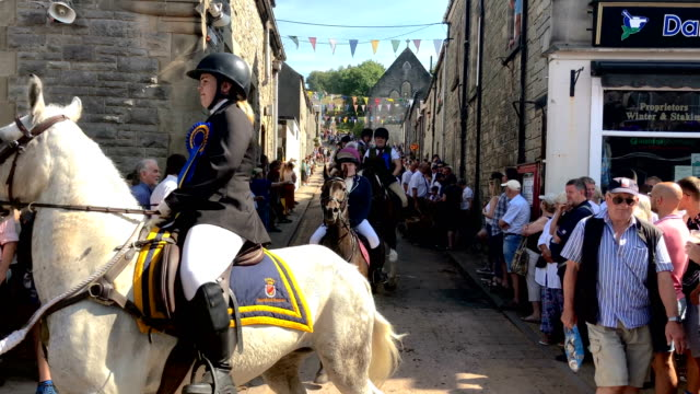 riders take part in the langholm common riding on july 27, 2018 in langholm, scotland. langholm, known by locals as the the muckle toon', has seen... - bagpipes stock videos & royalty-free footage