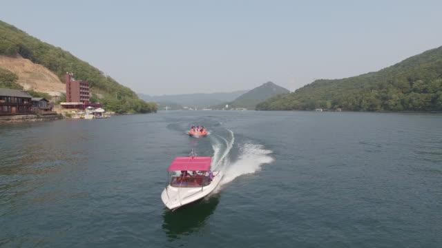 riding a bandwagon boat on cheongpyeongho lake / gapyeong-gun, gyeonggi-do, south korea - jet boating stock videos & royalty-free footage