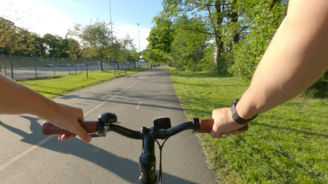 riding a bicycle in gothenburg city pov - man made object stock videos & royalty-free footage