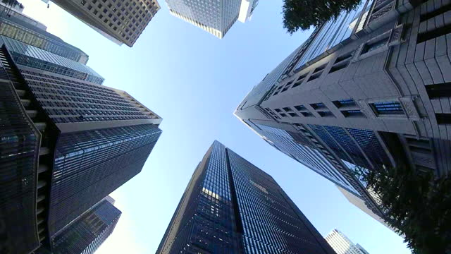 riding a bicycle in the city. look up and look around. riding bikes through the city, tokyo japan. action camera shoot. - plusphoto stock videos & royalty-free footage