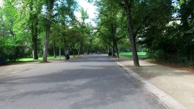 riding a bicycle in vondelpark amsterdam - vondelpark stock videos and b-roll footage
