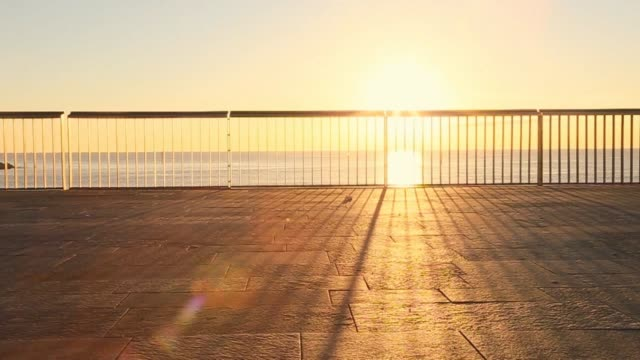 riding a bicycle on the early morning in the barcelona shoreline boardwalk on sunrise. - promenade stock videos & royalty-free footage