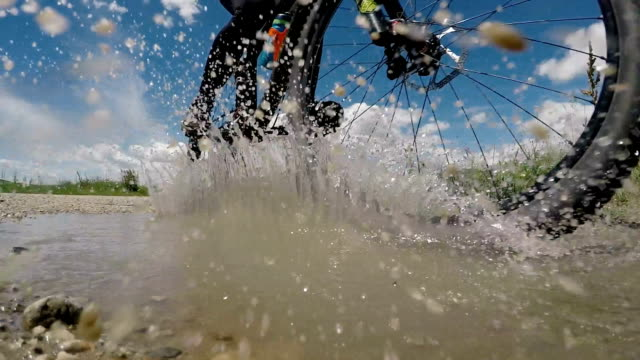 riding a bike through water, super slow motion - extreme sports stock videos & royalty-free footage