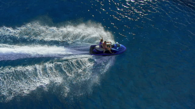 riding a jet boat over the reef - jet ski stock videos & royalty-free footage