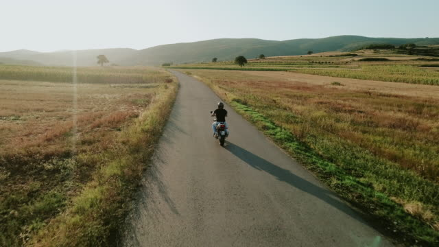 Riding a motorcycle in the countryside