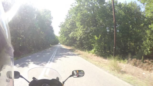 riding a motorcycle through the country side - ozgurdonmaz stock videos and b-roll footage