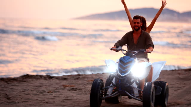riding a quad bike on a beach. - quadbike stock videos & royalty-free footage