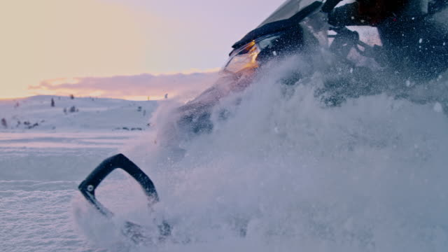 slo mo riding a snowmobile at dusk - northern europe stock videos & royalty-free footage