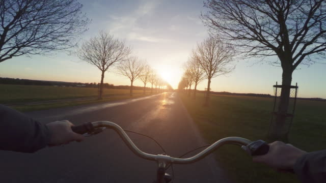 pov riding a urban road city bicycle general - handlebar stock videos & royalty-free footage