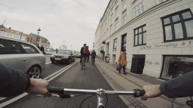 pov riding a urban road city bicycle in copenhagen - copenhagen video stock e b–roll