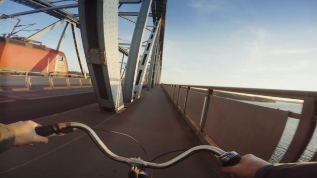 pov riding a urban road city bicycle - handlebar stock videos & royalty-free footage