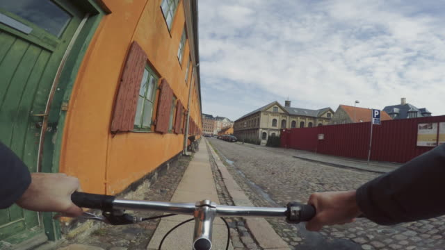 pov riding a urban road city bicycle - copenhagen video stock e b–roll