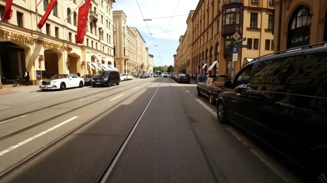 riding bicycle in central munich - munich stock videos & royalty-free footage