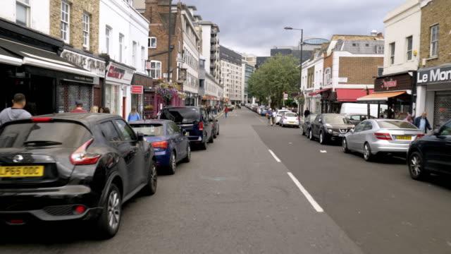 radfahren in london wilton road - kamerafahrt auf schienen stock-videos und b-roll-filmmaterial