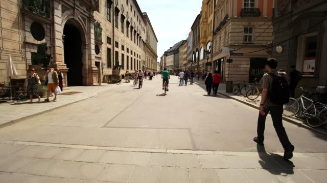 riding bicycle in munich residenz street - german culture stock videos & royalty-free footage