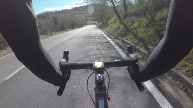 riding bicycle in tuscany on winter season. pov - racing bicycle stock videos and b-roll footage