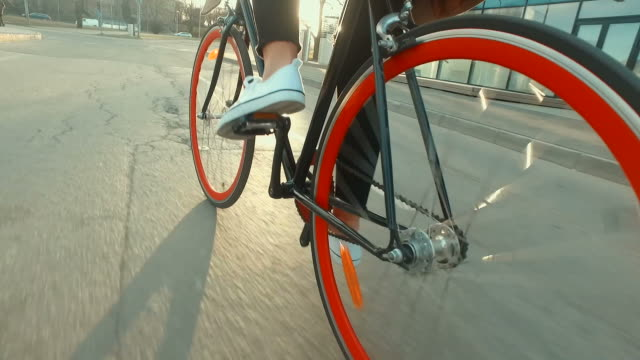 riding bicycle into the sunset - bicycle stock videos & royalty-free footage