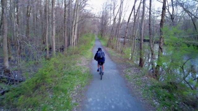 Riding bike on a towpath