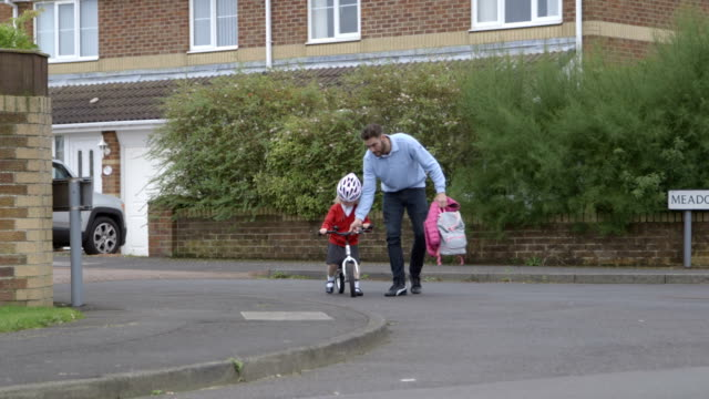 riding bike to school - primary school child stock videos & royalty-free footage