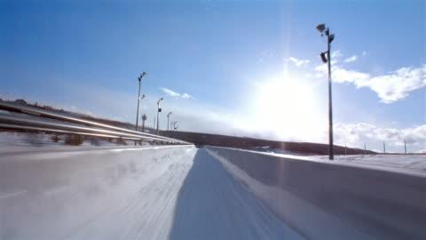 pov, riding bob sled, calgary, canada - bobsledding stock videos & royalty-free footage