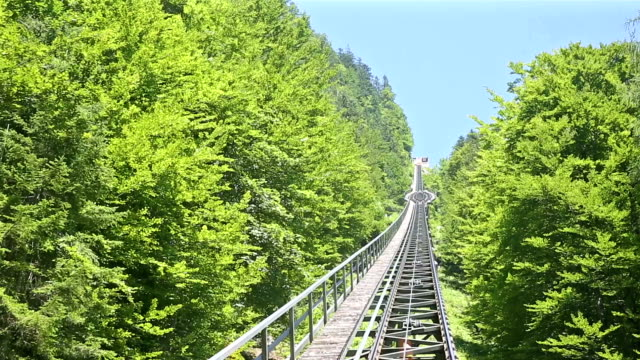 riding cable car to viewpoint of hallstatt village and lake, austria - salzkammergut stock videos and b-roll footage