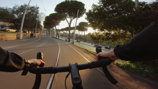 pov riding: dangerous road bicycle training in the city of rome - tram stock videos & royalty-free footage