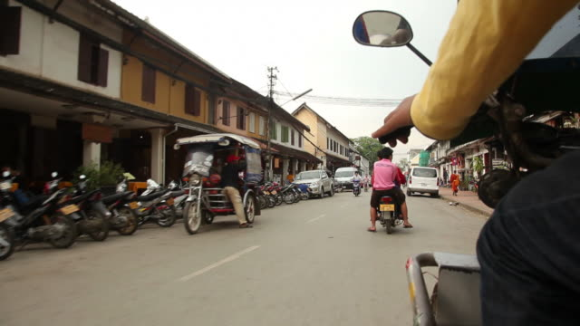 WS POV Riding down street in town / Luang Prabang, Laos