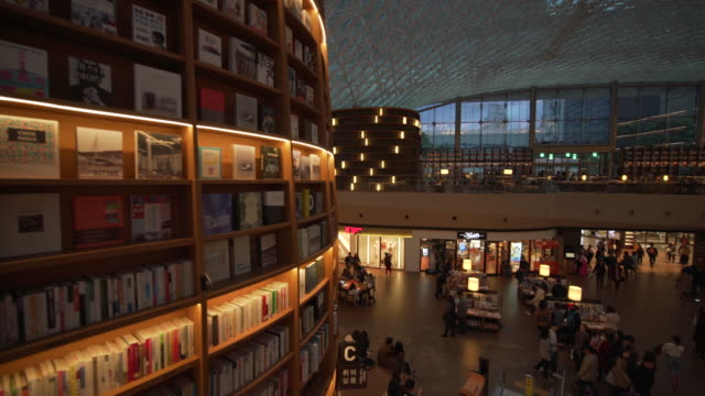 riding escalator in starfield library, pov - bibliothek stock-videos und b-roll-filmmaterial