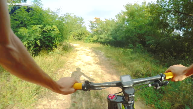 pov riding fast. - bicycle trail outdoor sports stock videos & royalty-free footage