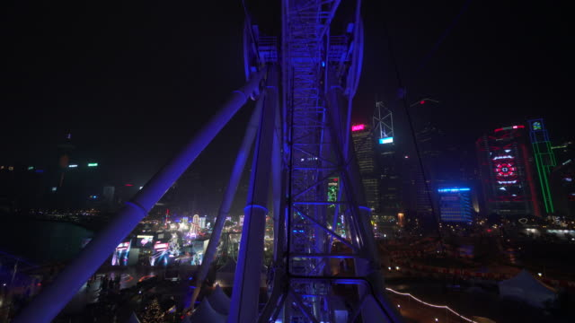 pov, riding ferris wheel in hong kong - steel cable stock videos & royalty-free footage