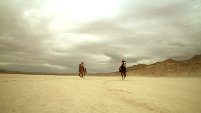 (Slow Motion) Riding Horses in the Dessert 01