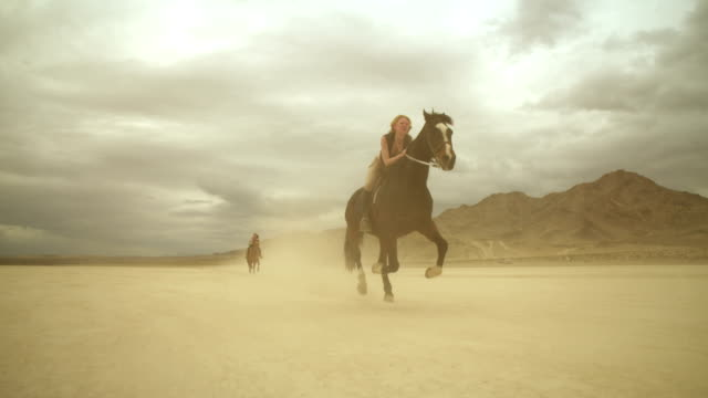 (Slow Motion) Riding Horses in the Dessert 03