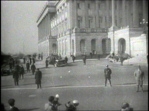 "riding in car outside capitol building, crowds / crowds in times square listening to fdr radio speech / fdr giving speech, ""we will gain the... - 1941 stock-videos und b-roll-filmmaterial"